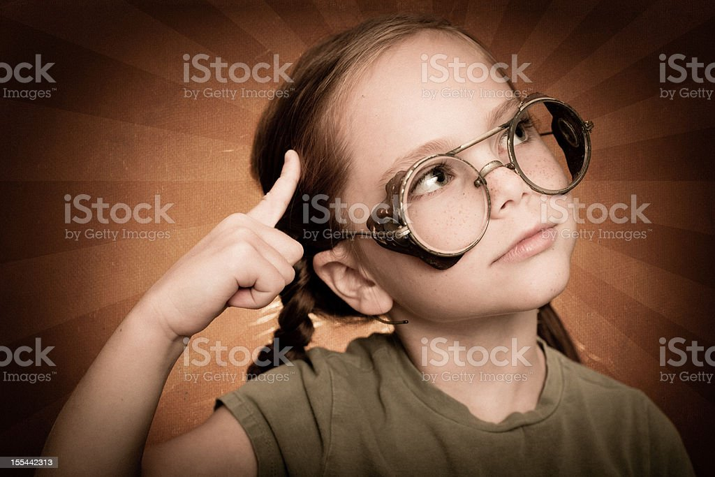Thinking Little Red-Haired Girl Wearing Steampunk Glasses royalty-free stock photo