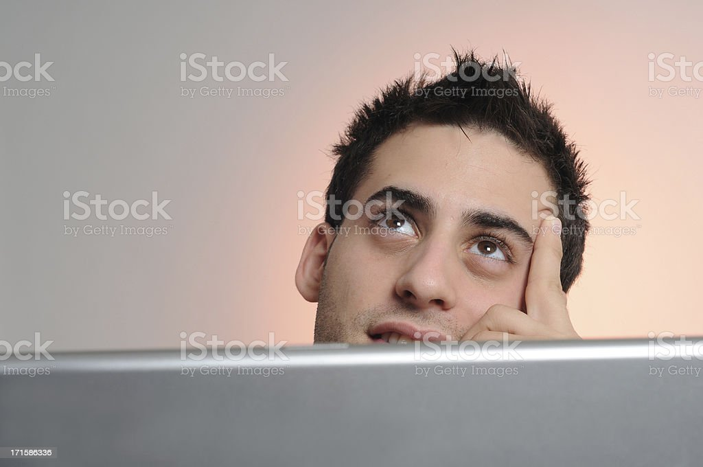 Thinking Man looking up royalty-free stock photo
