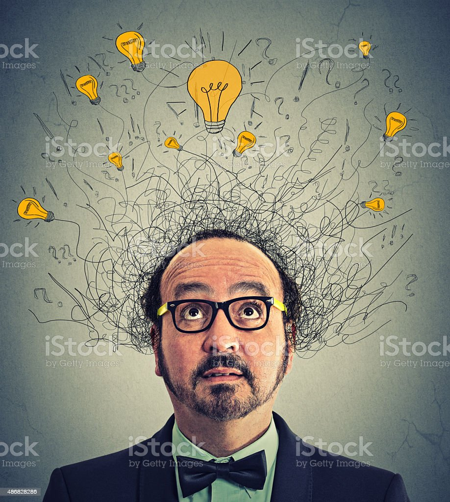 Thinking man question signs light idea bulbs above head stock photo