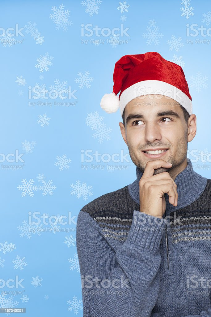 Thinking man wearing christmas hat. royalty-free stock photo