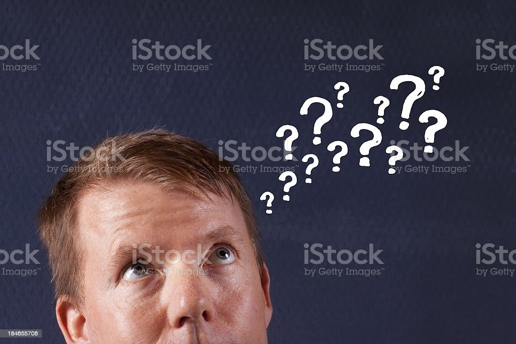 Thinking Man With Many Questions stock photo