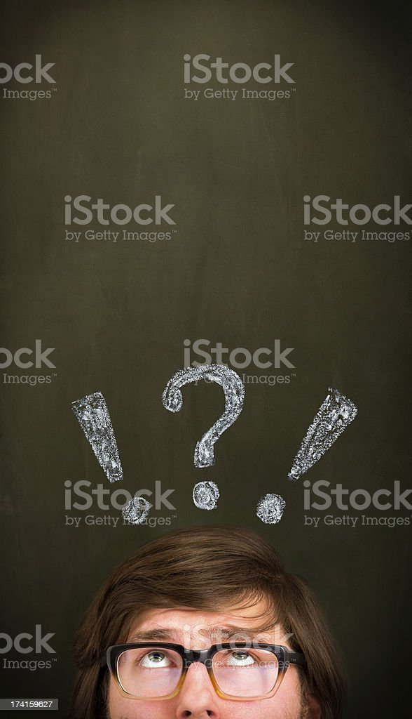 Thinking man with question mark on blackboard royalty-free stock photo