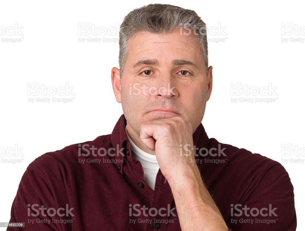 Thinking Mature Man Looking At Camera stock photo