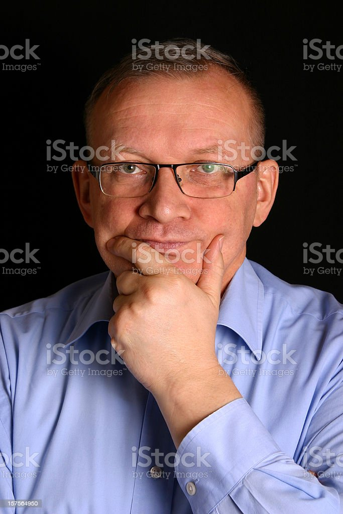 Thinking mature man stock photo