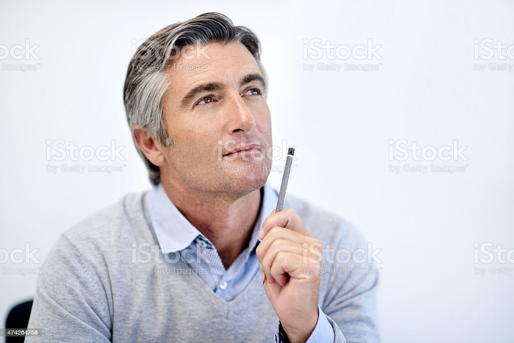 Thinking of his next business move stock photo