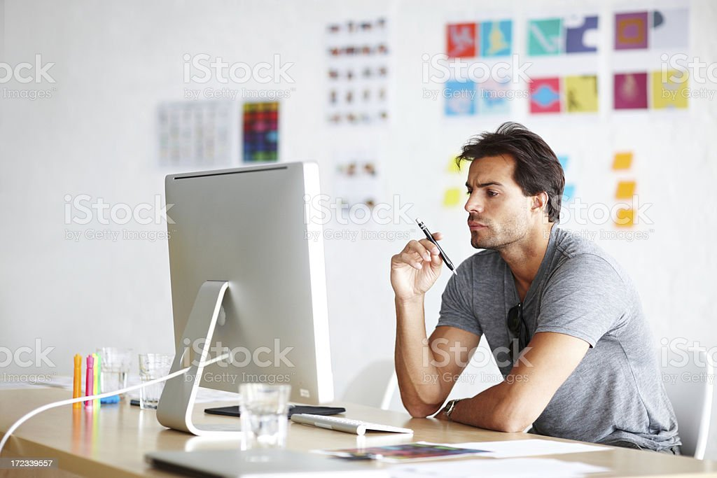 Thinking of ideas for his project royalty-free stock photo