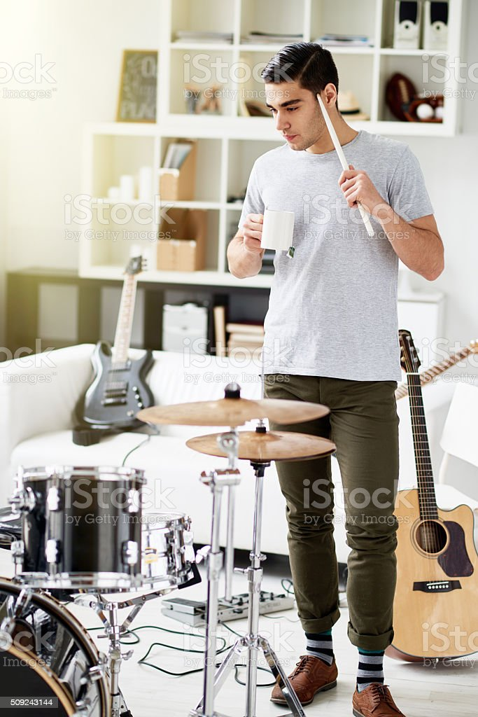 Thinking of new hit song stock photo