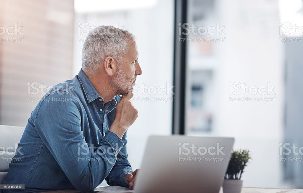 Thinking of ways to transform his ideas into successful results stock photo