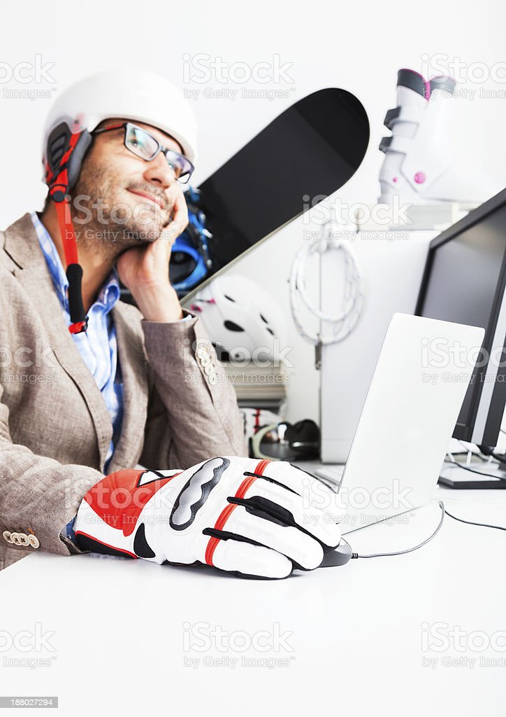 Thinking of Winter Ski Vacation. Business man at the Office. stock photo