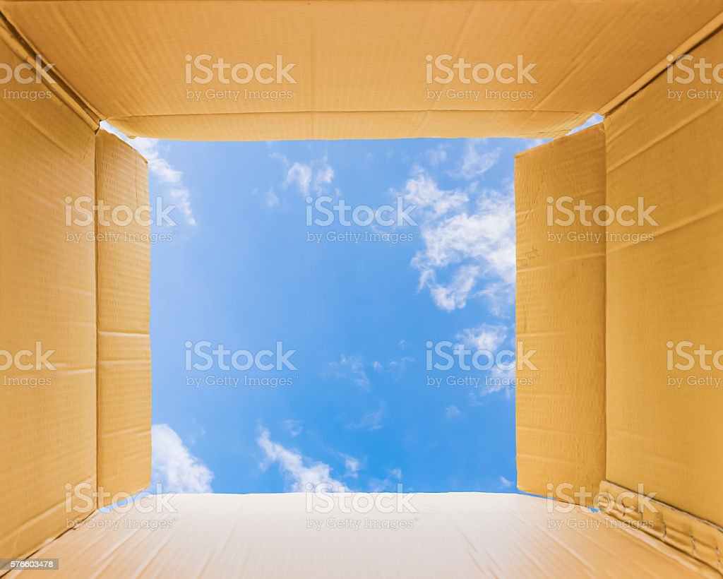 Thinking outside the open box to sky stock photo