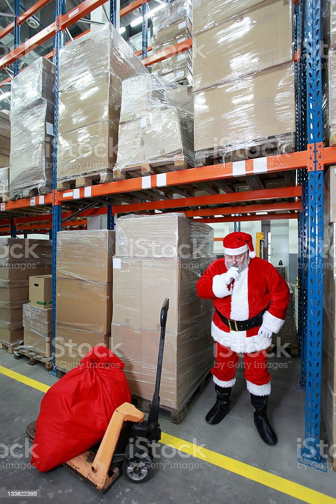 thinking santa claus in storehouse royalty-free stock photo