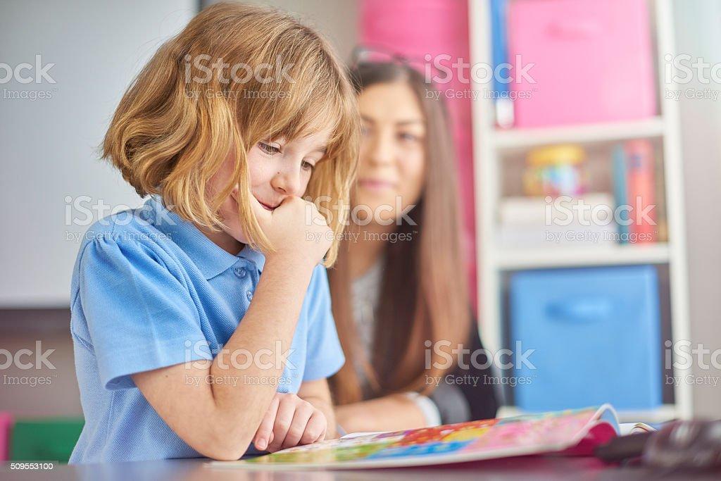 thinking schoolgirl stock photo