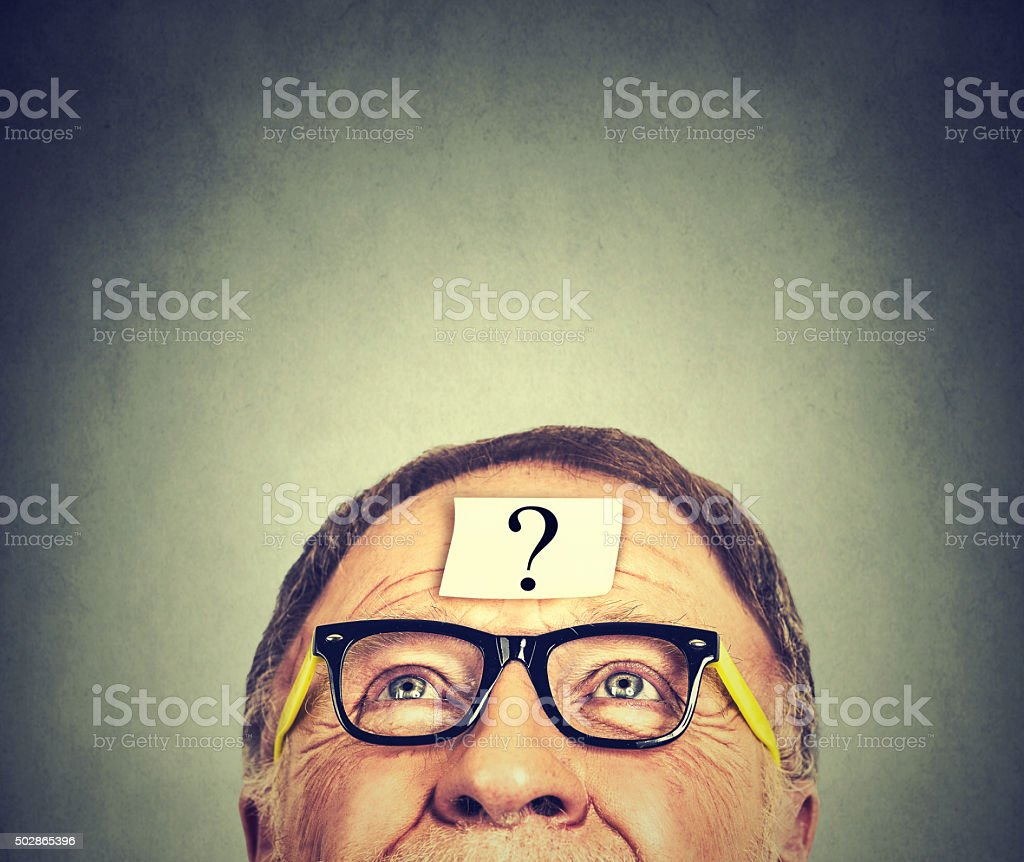 thinking senior man with question mark stock photo