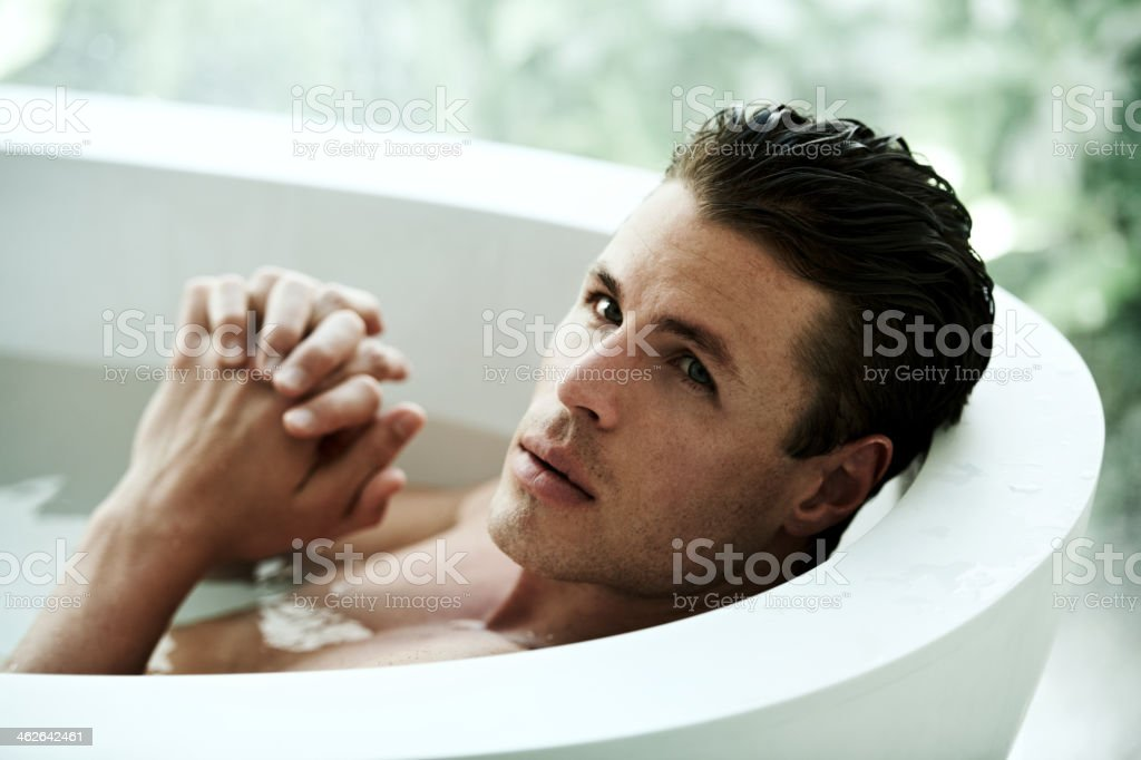 Thinking time in the tub stock photo