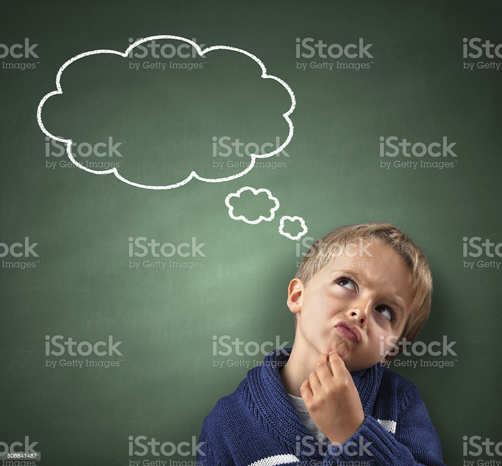 Thinking with thought bubble on blackboard stock photo
