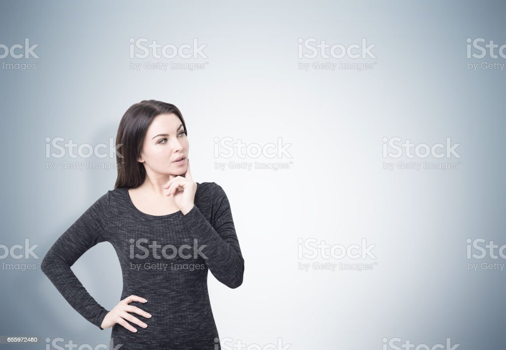 Thinking woman in a dress stock photo