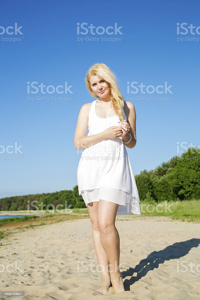 Thinking woman in white dress with hairs royalty-free stock photo