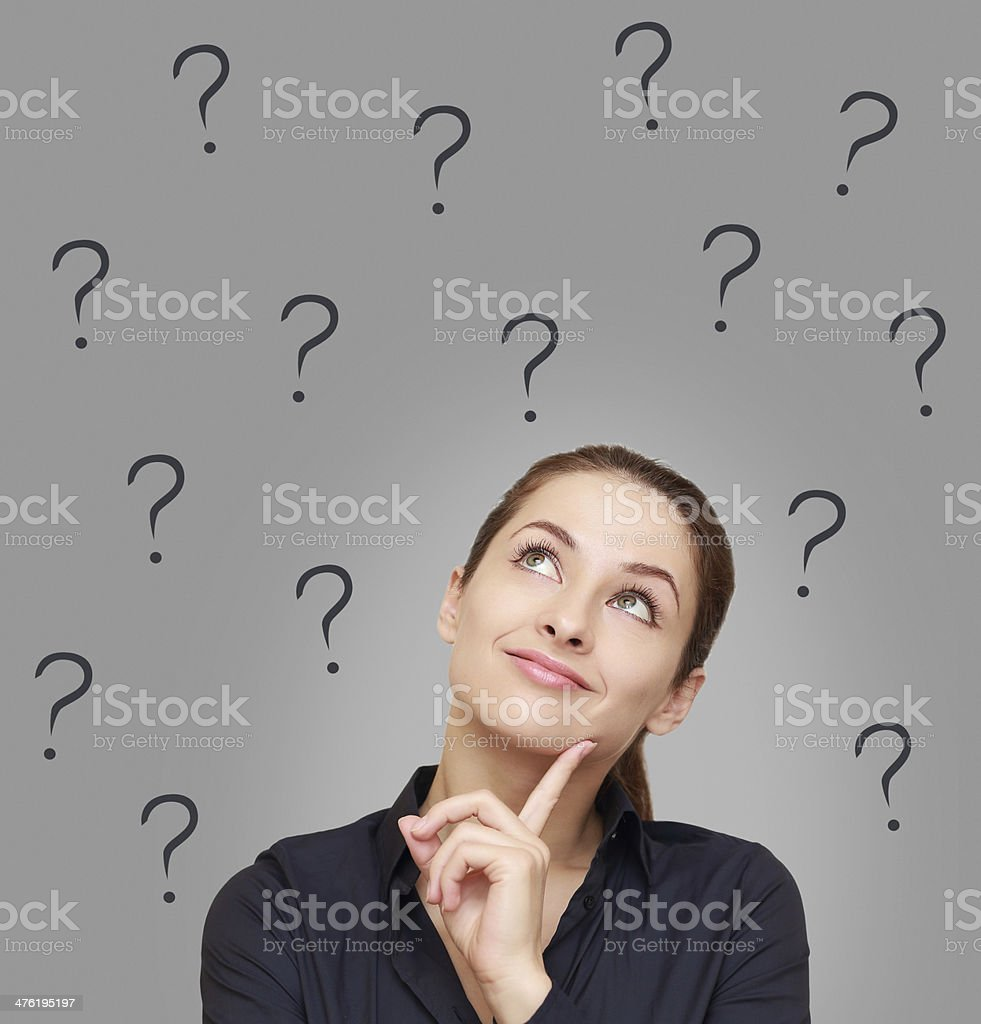 Thinking woman looking up on many questions mark royalty-free stock photo