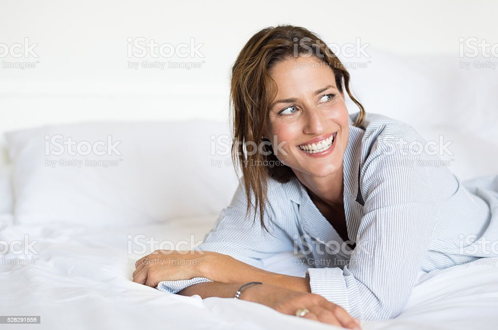 Thinking woman on bed stock photo