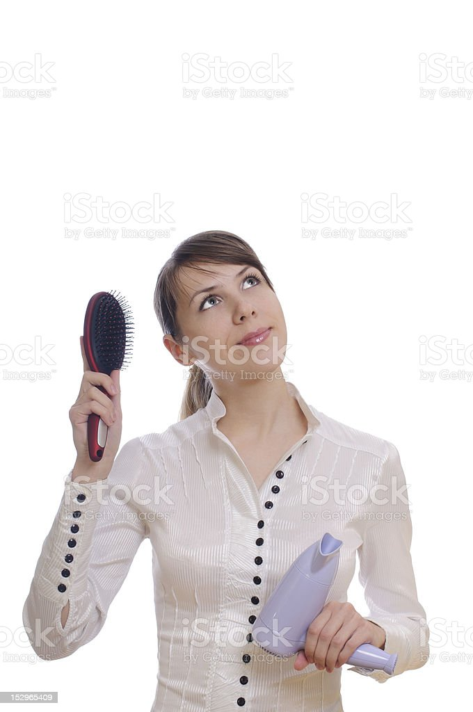 thinking woman with hairbrush and dryer royalty-free stock photo