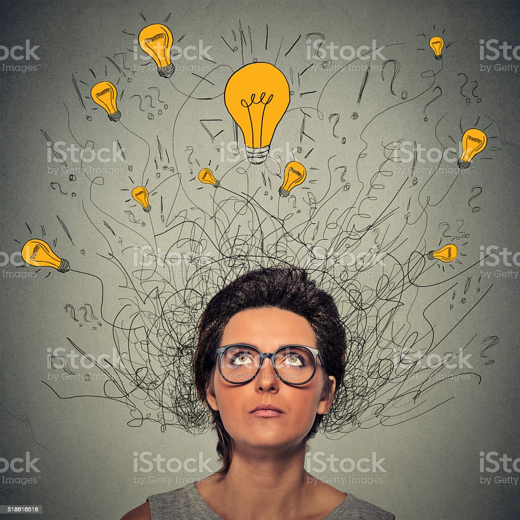 thinking woman with question signs and lightbulbs above head stock photo