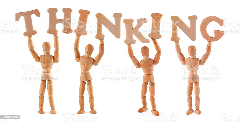 Thinking - wooden mannequin holding this word royalty-free stock photo
