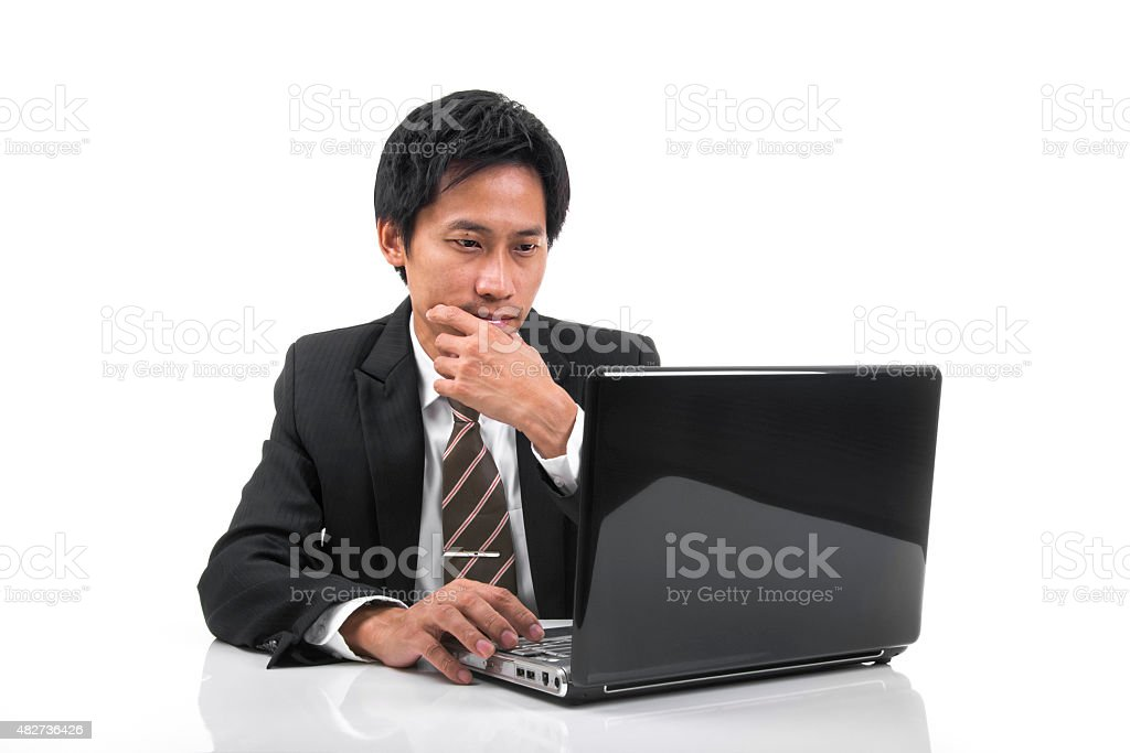 Thinking Young Asian Businessman royalty-free stock photo