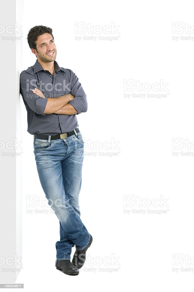 Thinking young man full length stock photo