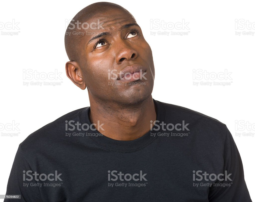 Thinking Young Man Looking Up Daydreaming royalty-free stock photo