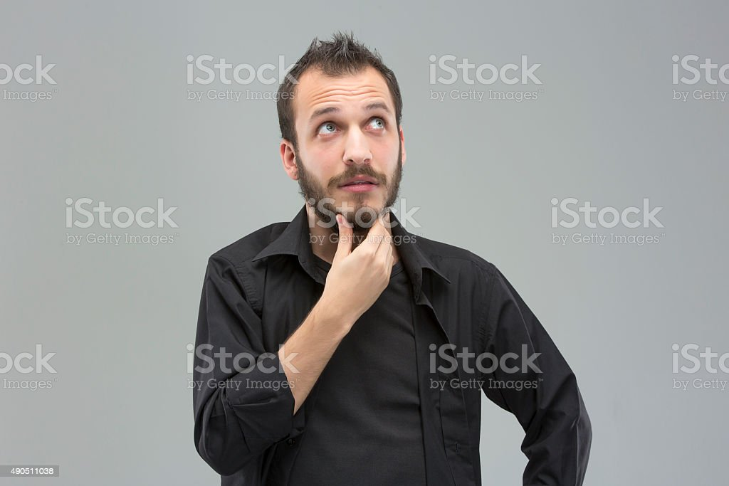 Thinking Young Man stock photo