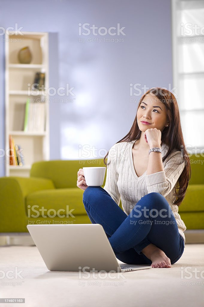 thinking young woman royalty-free stock photo