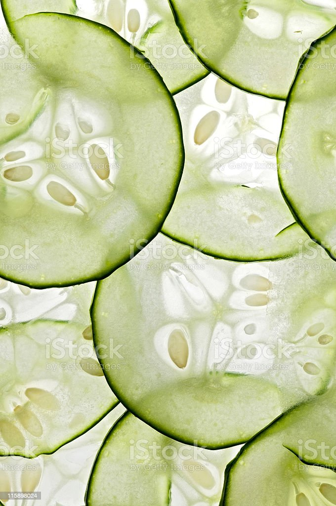 Thinly sliced cucumbers with bright light in the background royalty-free stock photo