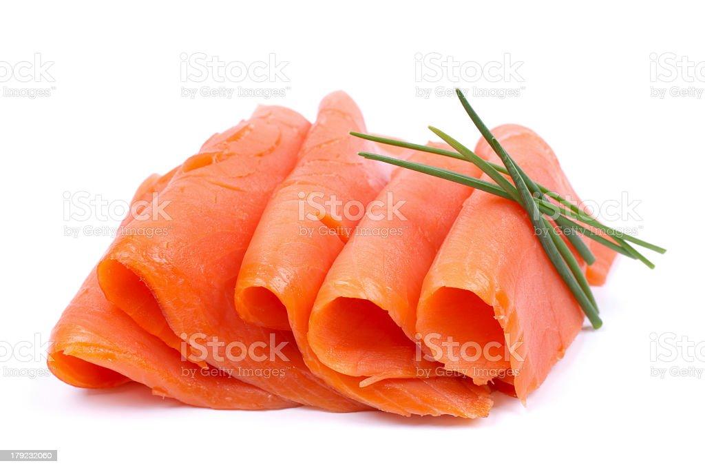Thinly sliced fresh salmon arranged on white background stock photo