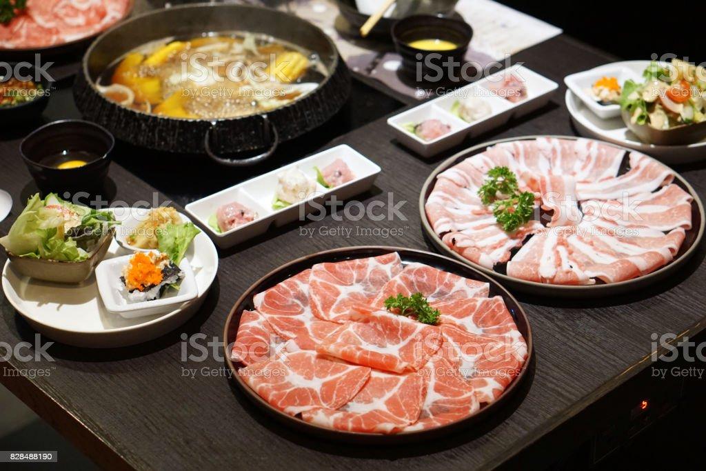 Thinly sliced of raw pork for Japanese hot pot also known as Shabu Shabu or Sukiyaki. stock photo