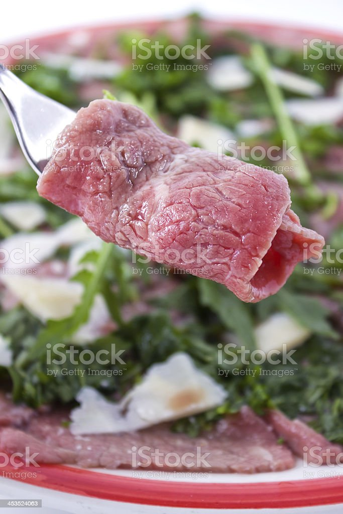 Thinly sliced raw meat: Carpaccio stock photo