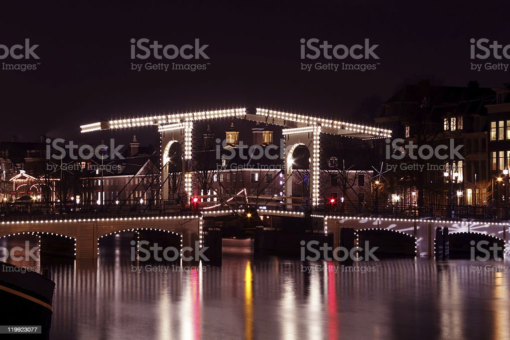Thiny bridge by night in Amsterdam the Netherlands stock photo