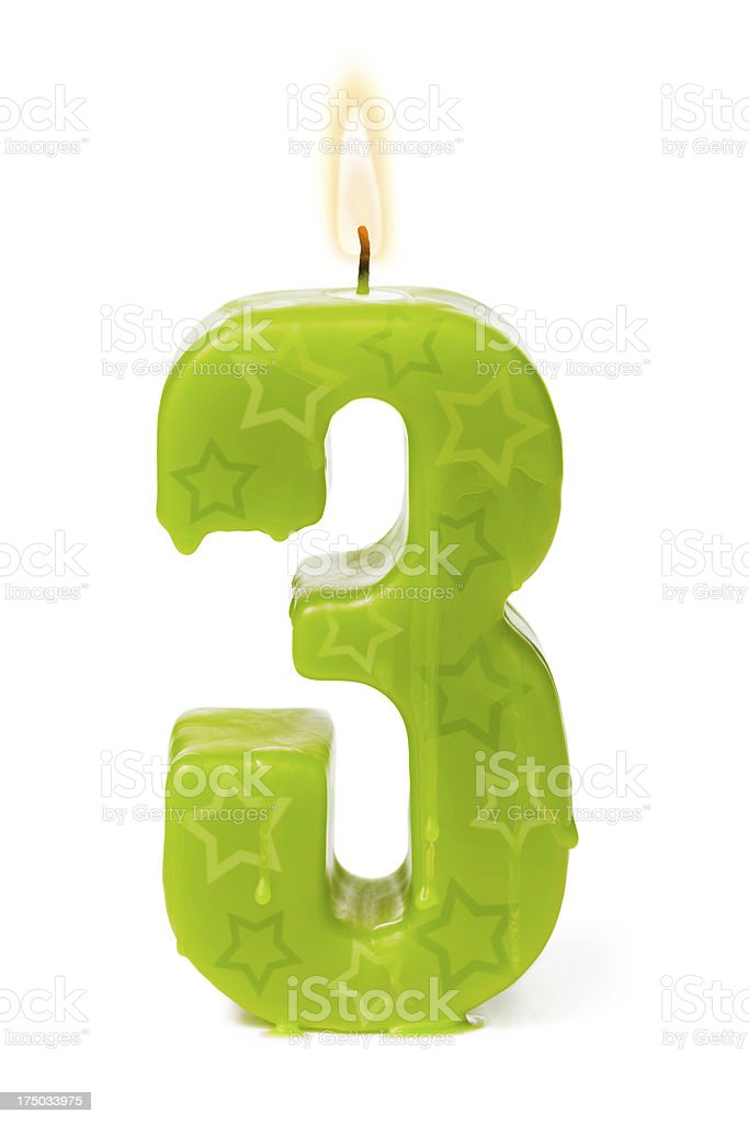 Third 3rd birthday or anniversary candle royalty-free stock photo