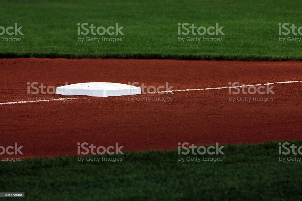 Third base on baseball field stock photo