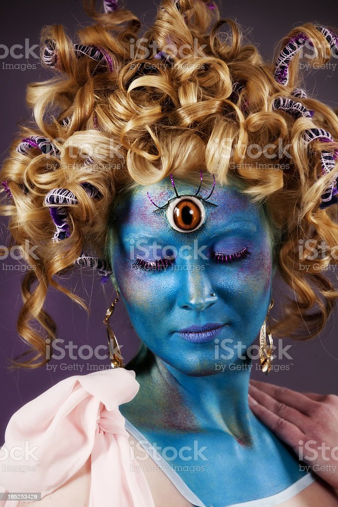 Third eye: blue-faced mystical creature stock photo