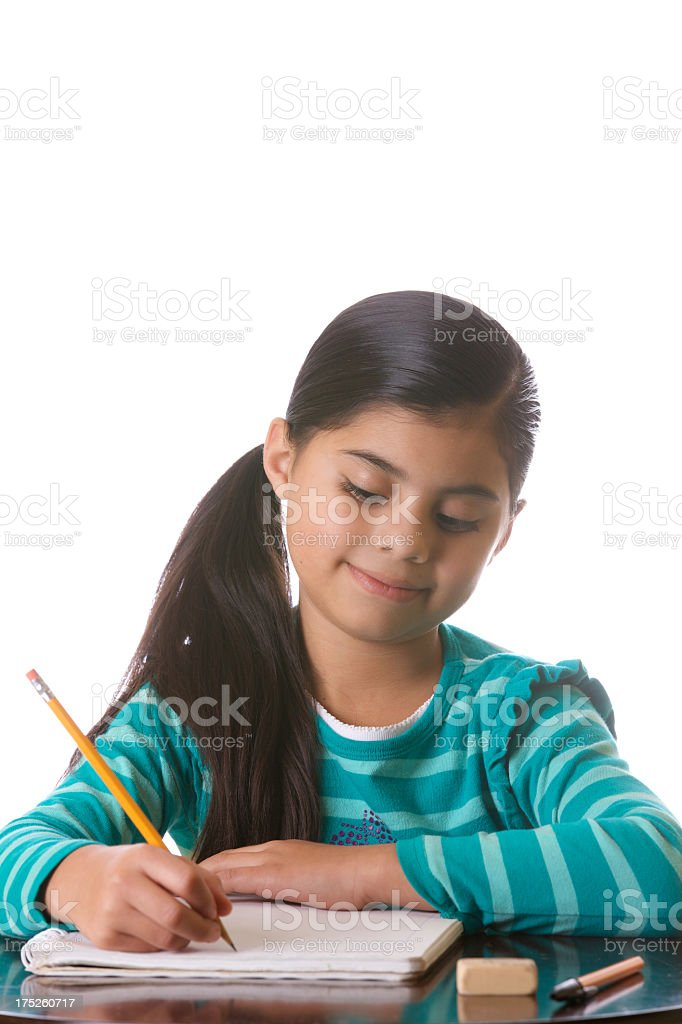 Third grader little girl doing her homework. royalty-free stock photo