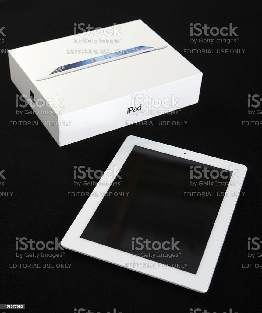 Third-generation Apple iPad next to its delivery box stock photo