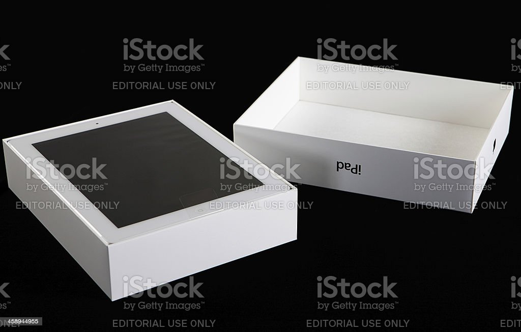 Third-generation Apple iPad with lid removed during unwrapping stock photo
