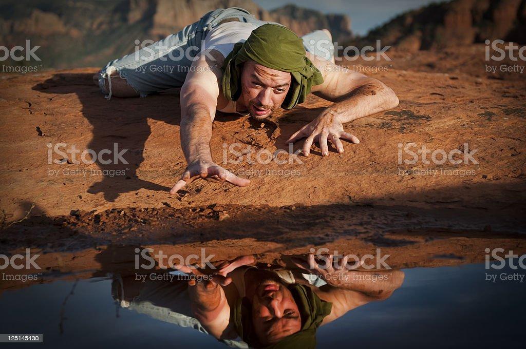 Thirsty Man in the Desert stock photo