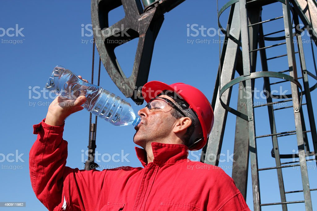 Thirsty Oil Industry Worker stock photo