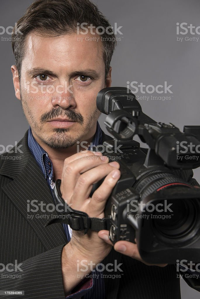 Thirty something Hispanic man holding a video camera headshot royalty-free stock photo