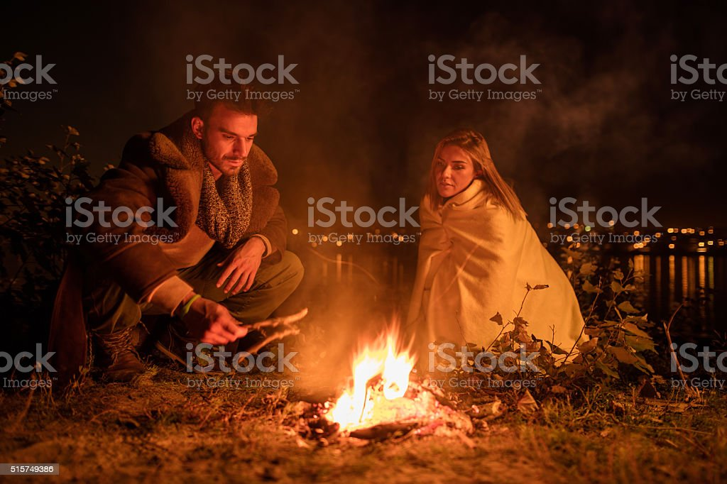 This campfire will keep us warm in the night! stock photo