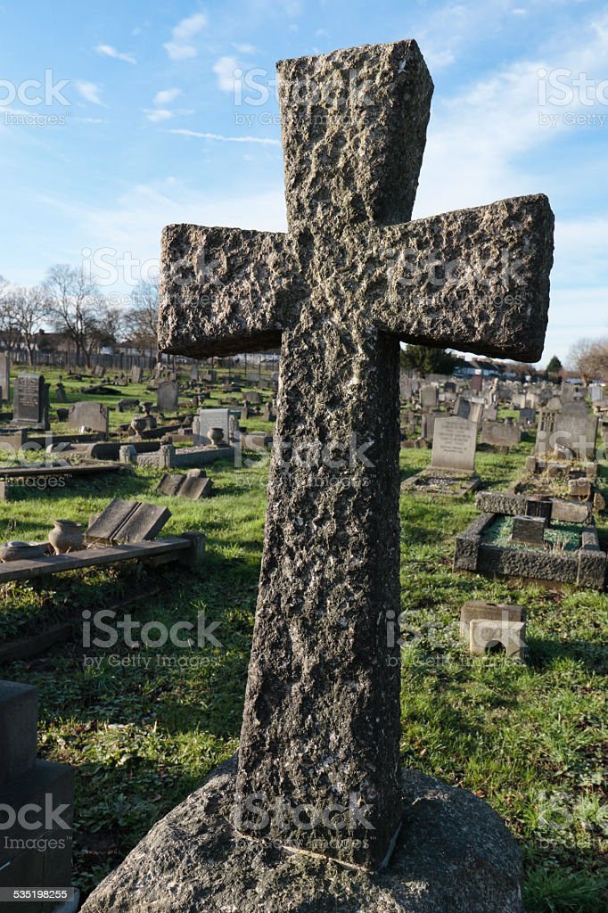 St. George's cross in stone graveyard stock photo