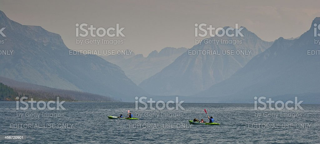 Kayakers on Lake McDonald royalty-free stock photo