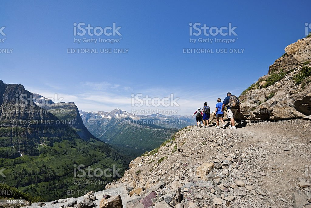 Hikers on a Narrow Ledge royalty-free stock photo