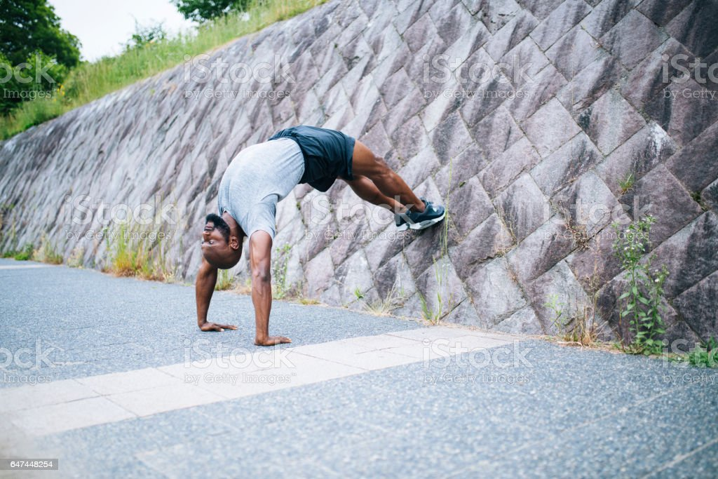 This handstand is incredible stock photo